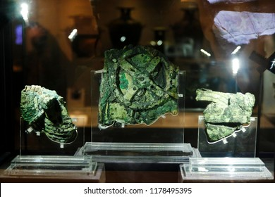 Visitors look at a fragment of the 2,100-year-old Antikythera Mechanism, believed to be the earliest surviving mechanical computing device, is seen at  Museum in Athens, Greece on Aug. 26, 2018
