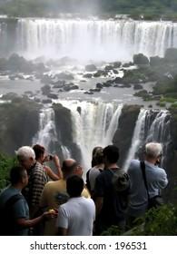 Visitors looking at waterfalls