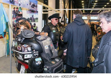 Visitors and participants of moto salon. St. Petersburg Russia - 15 April, 2017. International Motor Show IMIS-2017 in Expoforurum. Visitors and participants of the annual moto-salon in St. Petersburg