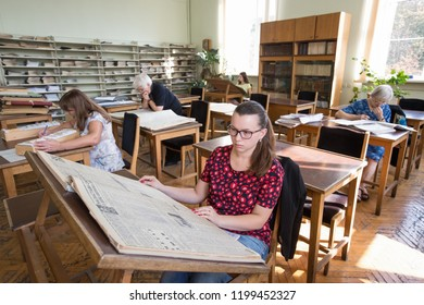 Visitors read books and newspapers in the reading room of Vernadskyi National library of Ukraine in Kiev, Ukraine. October 14, 2015.