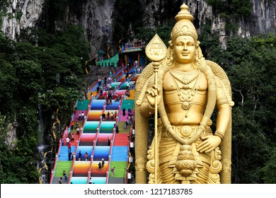 Visitors walk up the newly-painted 272-steps staircase leading to Malaysia's Batu Caves Hindu temple in Kuala Lumpur on October 31, 2018.
