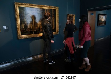 Visitors wear face masks, to prevent the spread of coronavirus, as they look at paintings at the Royal Museum of Fine Arts in Brussels, Belgium on May 19, 2020.
