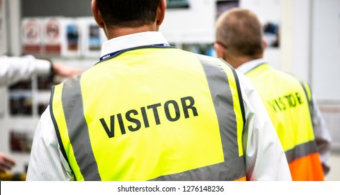 Visitors wearing PPE in a manufactoring plant