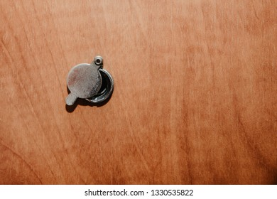 Visor in the door. Peeping people, the concept of looking behind the door. Silver visor on wooden doors. Safety and care for the comfort of living in an apartment, home.