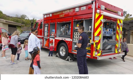 Vista, CA / USA - October 13, 2018: People interact with firefighters and explore trucks during fire prevention month open house