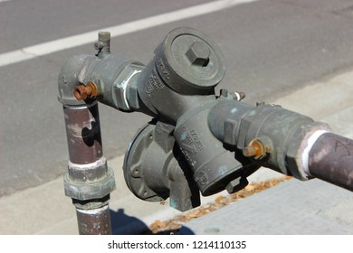 Vista, CA / USA - October 22, 2018: A double-check backflow preventer on a two inch water main line, required in California