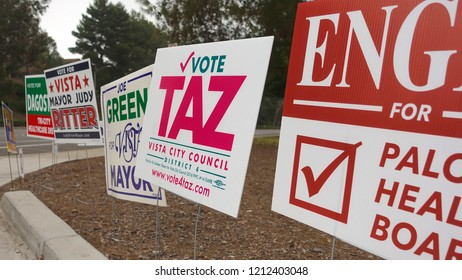 Vista, CA / USA - October 25, 2018: Election signs cluster every street corner, as local election battles heat up