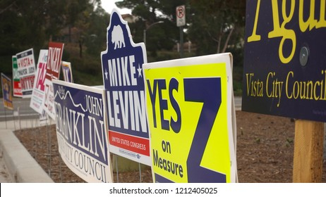 Vista, CA / USA - October 25, 2018: Multitude of election signs on a street corner, as California voters prepare for midterm vote
