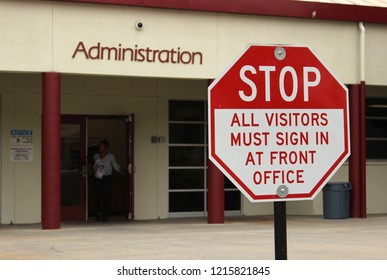 Vista, CA / USA - October 25, 2018: A sign tells visitors of a high school that they need to sign in