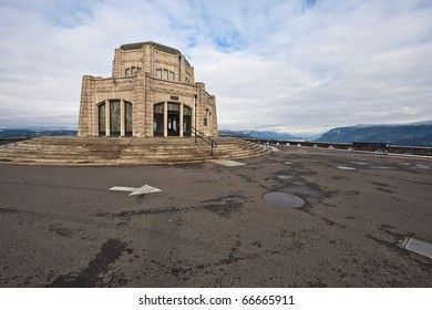 Vista House at Crown Point in Columbia River Gorge receding under cloudy winter sky, Oregon, U.S.A.