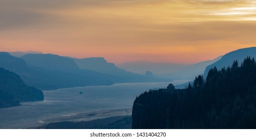 Vista House at sunrise in the Columbia River Gorge