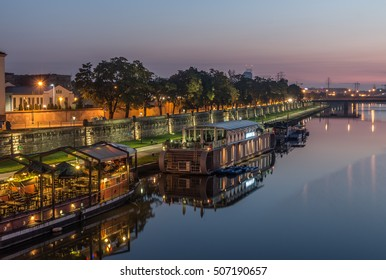 Vistula boulevards in the night in Krakow, Kazimierz district with moored ships