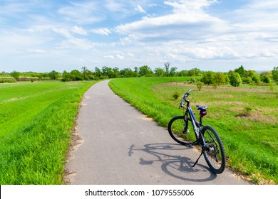VISTULA RIVER CYCLING TRACK, POLAND - APR 28, 2018: Mountain bike parking on cycling track near Vistula river during spring sunny day. Cycling is very popular activity among Poles.