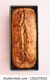 Visual guide made of single photo showing the different step to prepare a banana bread, cook the mixture for 40 minutes to 180 ,top view over a pink background, follow the next visual steps.