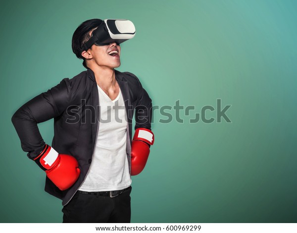 Visual reality concept.Young Asian business man using Visual reality or VR headset man getting experience using VR-headset glasses.