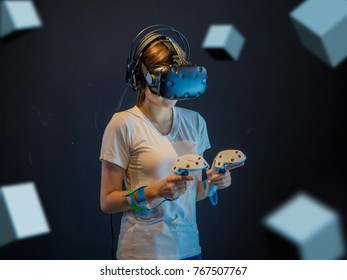 Visual reality concept.Young Asian woman using Visual reality or VR headset.Woman getting experience using VR-headset glasses.