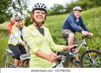 Vital group seniors go on vacation by bike in nature