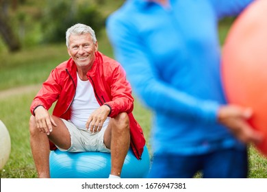 Vital senior man takes break in a gymnastics course in nature