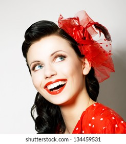 Vitality. Cheerful Young Woman with Red Bow enjoying. Pleasure