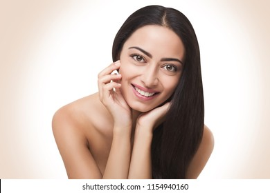 Vitality, wellbeing and youth concept. Portrait of charming woman with flawless smooth skin on white background