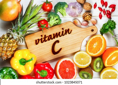 Vitamin C in fruits and vegetables. Natural products rich in vitamin C: oranges, lemons, dried fruits rose, red pepper, yellow pepper, kiwi, parsley leaves, garlic, tomatoes, walnuts, pineapple, mango