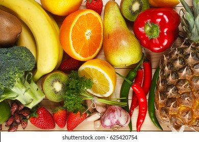 Vitamin C in fruits and vegetables. Natural products rich in vit. C as oranges, lemons, dried fruits rose, red pepper, kiwi, parsley leaves, garlic, banana, pear, apple, pineapple, chili and broccoli.