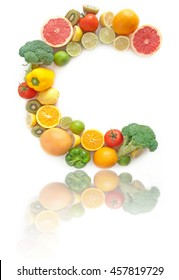 Vitamin C letter made of fruits and vegetables