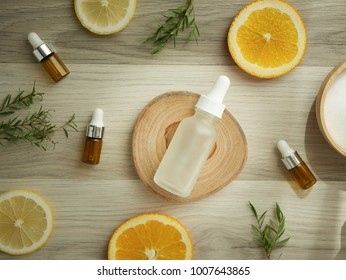 Vitamin c serum .natural organic cosmetic skincare product. Mock up with orange lemon .citrus.Top view on wood background.