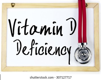 vitamin d deficiency text write on blackboard