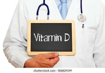 Vitamin D - Doctor with chalkboard and text on white background