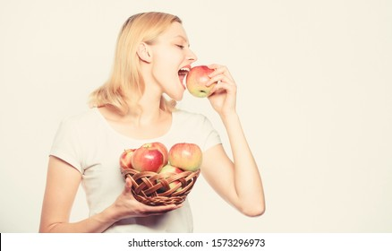 vitamin diet. Nature. farming green life. healthy food. autumn harvest. Spring seasonal fruit. Happy woman eating apple. orchard, gardener girl with apple basket. Pure feminine beauty.
