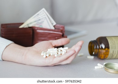 Vitamin, drugs, pills and tablets in hand