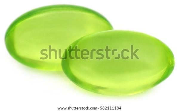 Vitamin e capsules over white background