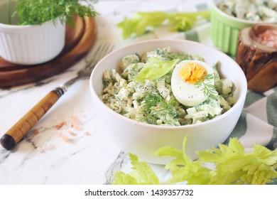 Vitamin light vegetable salad with dill, celery, eggs and Greek yogurt