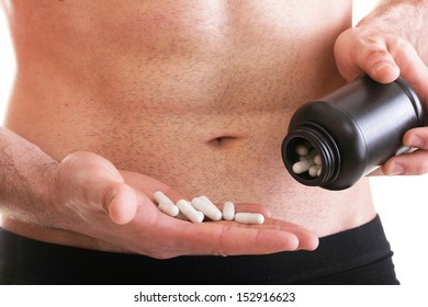 vitamin or pill drag tablet Man isolated offering pill in one and pills in bottle - in another hand. Copy space boxes with supplements
