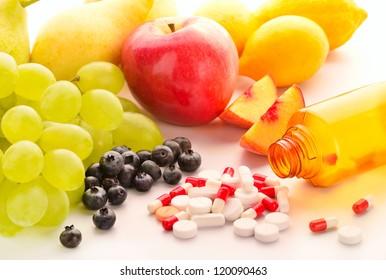 Vitamin pills with fresh fruits