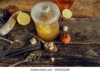 Vitamin tea with lemon and honey, ginger and spices. The concept of spring beriberi and colds. on a wooden table