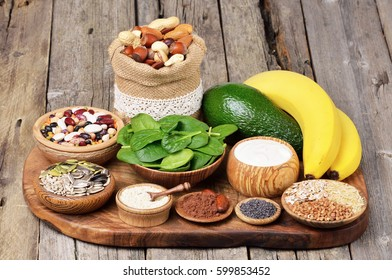 Vitamins. Foods containing magnesium on wooden table. Healthy diet eating concept.