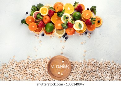 Vitamins in fruits and vegetables and vitamin pills. Top view, flat lay