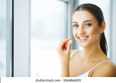 Vitamins. Healthy Eating. Happy Girl With Omega-3 Fish Oil Capsule. Healthy Diet Concept.