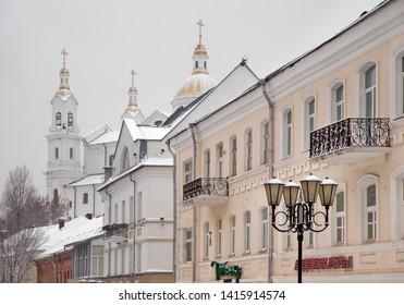 VITEBSK. BELARUS. 23 DECEMBER 2018 : Cathedral of Dormition - Assumption cathedral and old  street in Vitebsk. Belarus