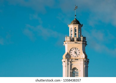Vitebsk, Belarus. Close Up Of Old Town Hall. City Hall, Clock Tower Is Famous Landmark In Sunny Day On Blue Sky Background