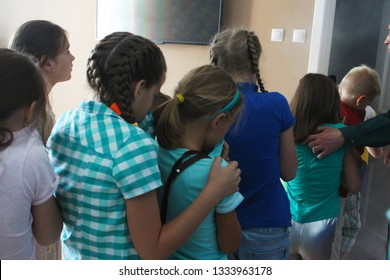 VITEBSK, BELARUS - JULY 13, 2018. Kids are in the Centre for Safety. Interactive learning about fire safety and evacuation training. Kids covering their noses and mouths to prevent inhaling fire smoke
