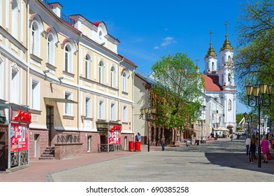 VITEBSK, BELARUS - MAY 23, 2017: Tolstoy Street with view of Holy Resurrection (Rynkovaya) Church, Vitebsk, Belarus. Unknown people walking down street