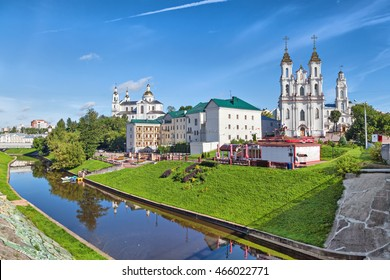 Vitebsk skyline with Resurrection church, town hall and buildings on the side of Vitba river, Belarus