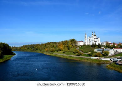 Vitebsk,Belarus - 06/10/2018: Assumption Cathedral of the Assumption on the hill and the monastery of the Holy Spirit on the Western Dvina River. Vitebsk, Belarus