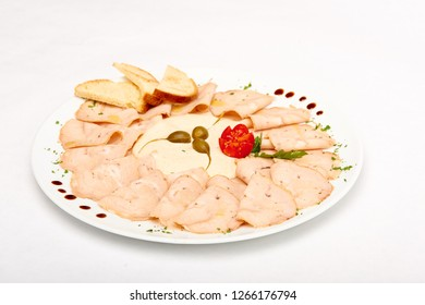 Vitello tonnato classic italian appertizer with veal and fish, served on white plate, isolated on white background