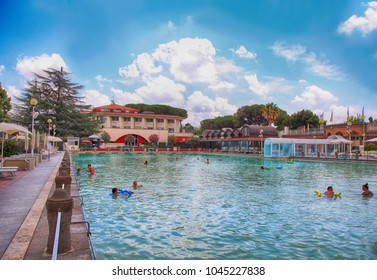 VITERBO, ITALY - JULY 24 2016: People relax in thermal natural hot pool of Terme dei Papi (meaning Spa of the Popes), Viterbo, Italy.