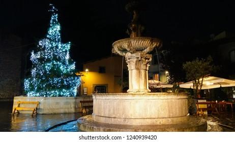 VITERBO, ITALY - NOVEMBER 25, 2018: Beautiful blue christmas tree and fountain in Piazza del Gesù of Viterbo, Lazio