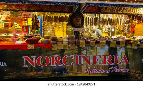 VITERBO, ITALY - NOVEMBER 25, 2018: Christmas market with cured meat in the little square of Viterbo city